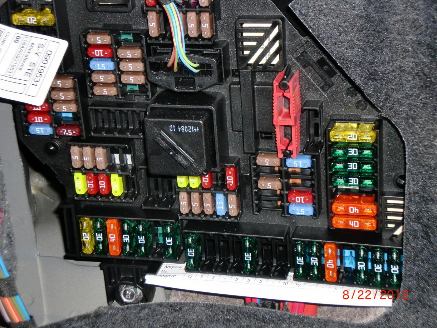 where is the fuse box in a 2013 bmw x6